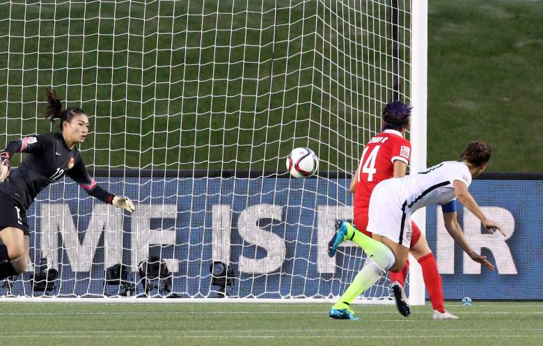 Carli Lloyd (in white) watches her header go in for a goal vs. China. (Getty)