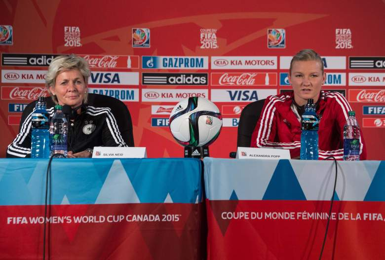 German coach Silvia Neid (L) and player Alexandra Popp hold a press conference at the Olympic Stadium in Montreal on June 29, 2015 on the eve of a 2015 FIFA Women's World Cup semifinal match against the US.    AFP PHOTO/NICHOLAS KAMM        (Photo credit should read NICHOLAS KAMM/AFP/Getty Images)