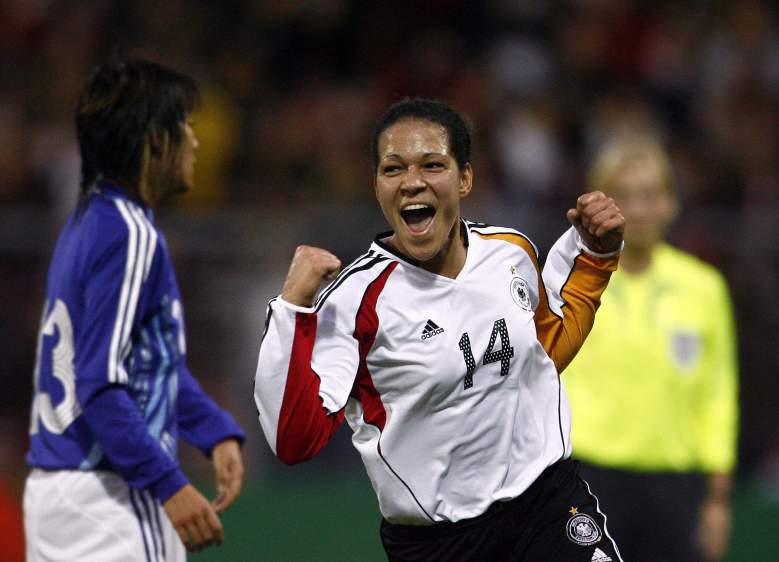 Karlsruhe, GERMANY:  Celia Okoyino da Mbabi (C) of Germany's national women's football team celebrates after scoring against Japan during their friendly match 23 November 2006 at the Wildpark stadium in Karlsruhe, southern Germany.    AFP PHOTO    DDP/TORSTEN SILZ    GERMANY OUT  (Photo credit should read TORSTEN SILZ/AFP/Getty Images)