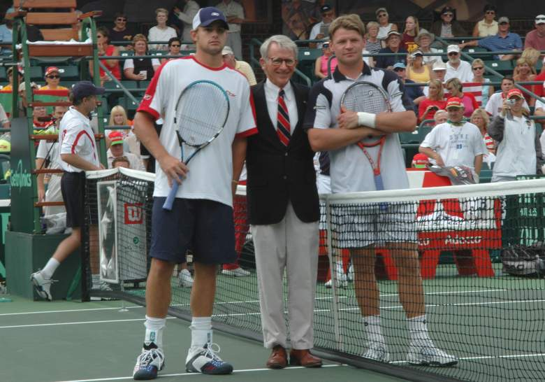 Andy Roddick  and Vladimir Voltchkov pose with  Charleston Mayor Joseph P. Riley Jr. before Roddick  wins the opening match  in the   2004 David Cup semifinal  September 24, 2004 at  Daniel Island, South Carolina. (Getty)