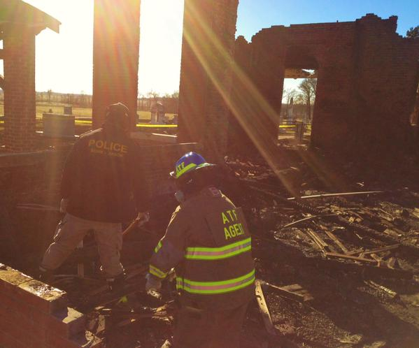 ATF agents investigating at the scene of a church fire. (ATF photo)
