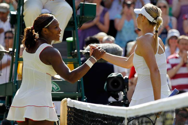 LONDON, ENGLAND - JUNE 28:  Serena Williams of USA (L) celebrates match point after her match against Maria Sharapova of Russia (R) on Day Seven of the Wimbledon Lawn Tennis Championships at the All England Lawn Tennis and Croquet Club on June 28, 2010 in London, England.  (Photo by Matthew Stockman/Getty Images)