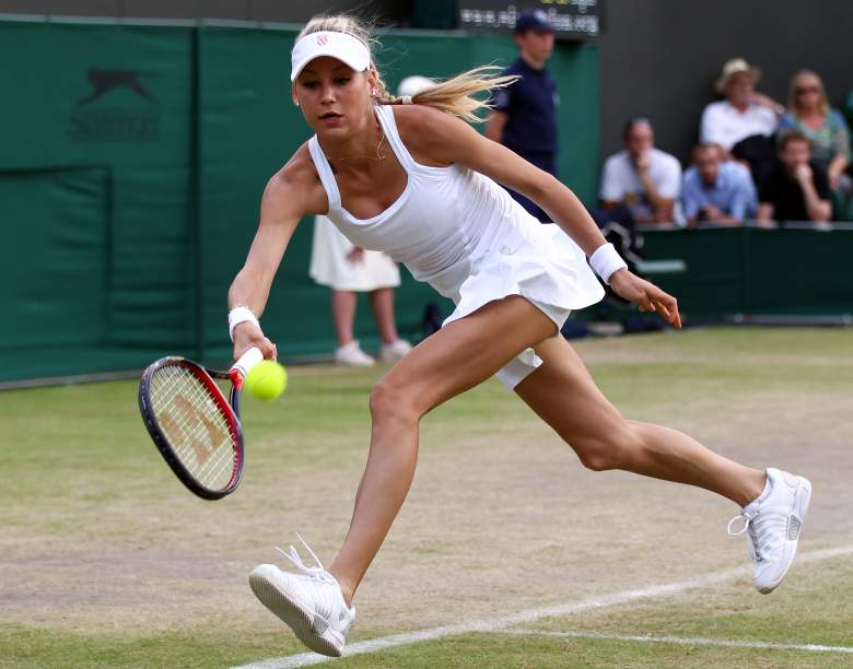 LONDON, ENGLAND - JUNE 29:  Anna Kournikova of Russia in action during her Ladies Invitational doubles match against Anne Hobbs and Samantha Smith of Great Britain on Day Eight of the Wimbledon Lawn Tennis Championships at the All England Lawn Tennis and Croquet Club on June 29, 2010 in London, England.  (Photo by Clive Brunskill/Getty Images)