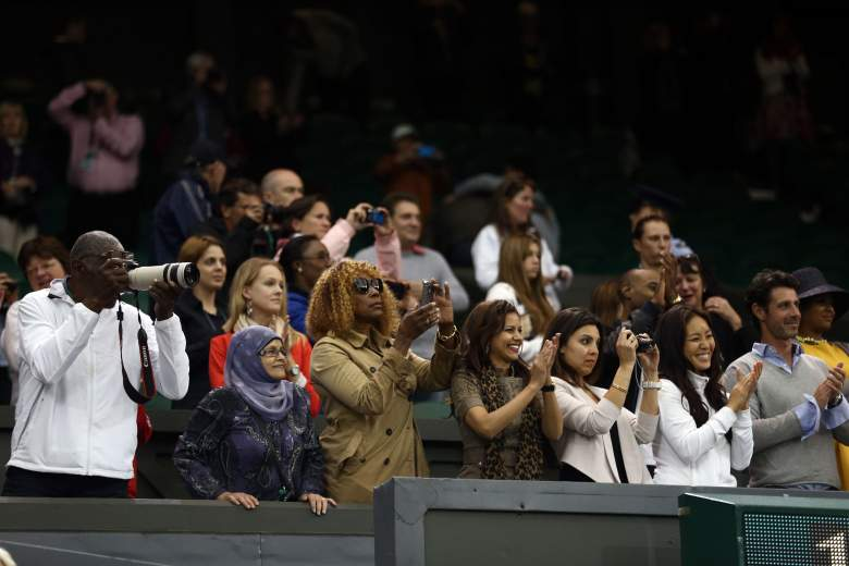 LONDON, ENGLAND - JULY 07:  Richard Williams (L) and Oracene Price (3L) take photographs as Serena Williams and Venus Williams of the USA win their Ladies? Doubles final match against Andrea Hlavackova and Lucie Hradecka of the Czech Republic on day twelve of the Wimbledon Lawn Tennis Championships at the All England Lawn Tennis and Croquet Club on July 7, 2012 in London, England.  (Photo by Paul Gilham/Getty Images)