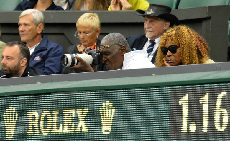 Father of US players Venus Williams and Serena Williams, Richard Williams (C) trains his camera on the court to photograph match point during his daughters' women's doubles final match victory against Czech Republic's Andrea Hlavackova and Czech Republic's Lucie Hradecka on day 12 of the 2012 Wimbledon Championships tennis tournament at the All England Tennis Club in Wimbledon, southwest London, on July 7, 2012. AFP PHOTO / LEON NEAL   RESTRICTED TO EDITORIAL USE        (Photo credit should read LEON NEAL/AFP/GettyImages)