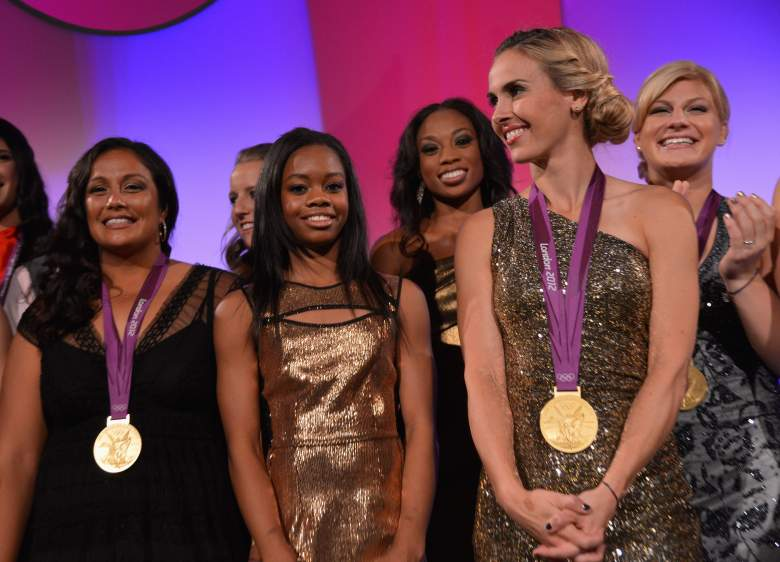 Mitts (Front Right) poses with her third Olympic gold medal in 2012. (Getty)