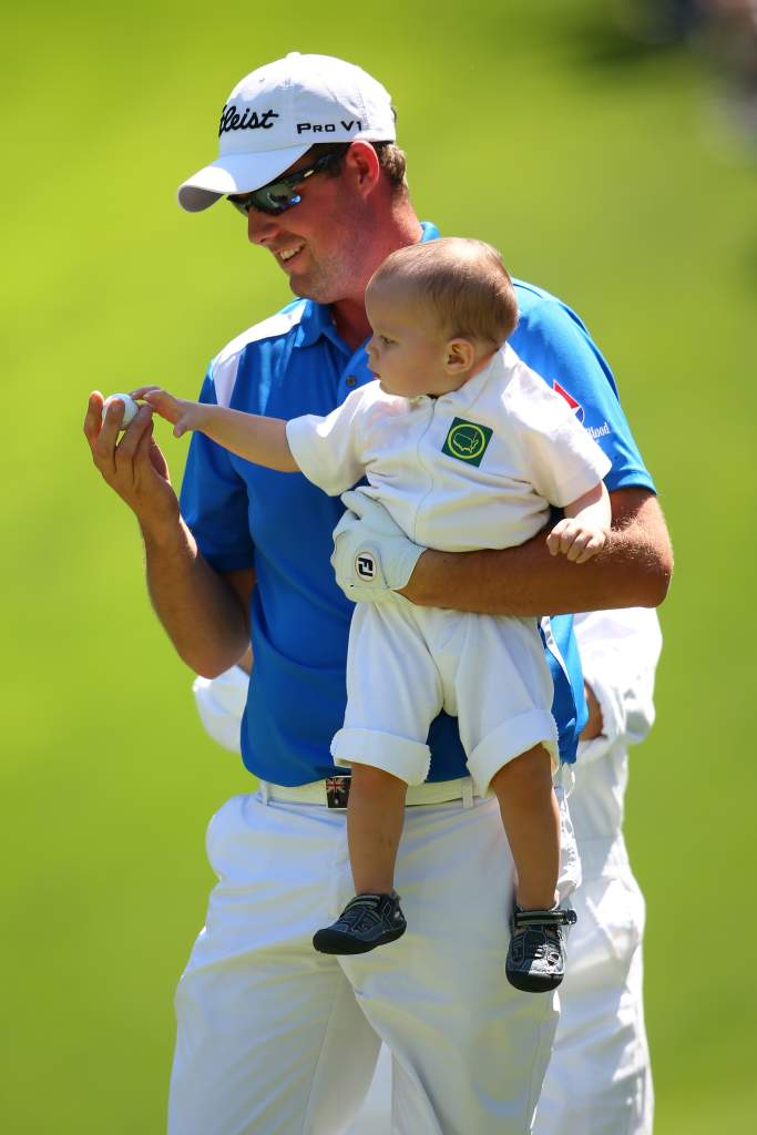 AUGUSTA, GA - APRIL 10:  Marc Leishman of Australia carries his child during the Par 3 Contest prior to the start of the 2013 Masters Tournament at Augusta National Golf Club on April 10, 2013 in Augusta, Georgia.  (Photo by Mike Ehrmann/Getty Images)