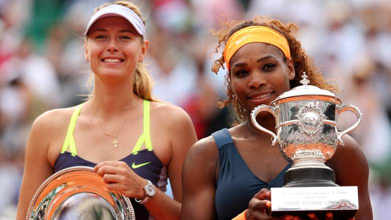 A common sight over the last decade: Serena Williams posing as the winner, and Maria Sharapova posing as the runner-up. (Getty)