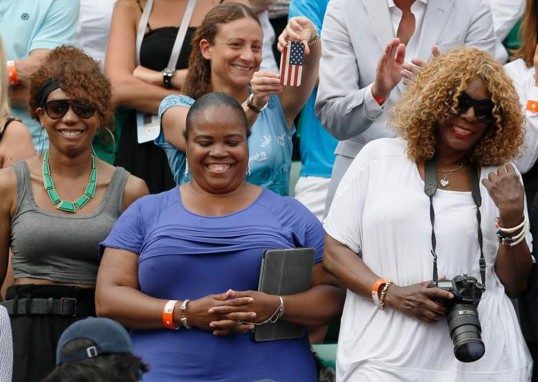 Serena Williams' sisters (From L) Venus, half sister Isha Price and their mother Oracene Price, react as Serena won the 2013 French tennis Open final at the Roland Garros stadium in Paris on June 8, 2013.  AFP PHOTO / PATRICK KOVARIK        (Photo credit should read PATRICK KOVARIK/AFP/Getty Images)