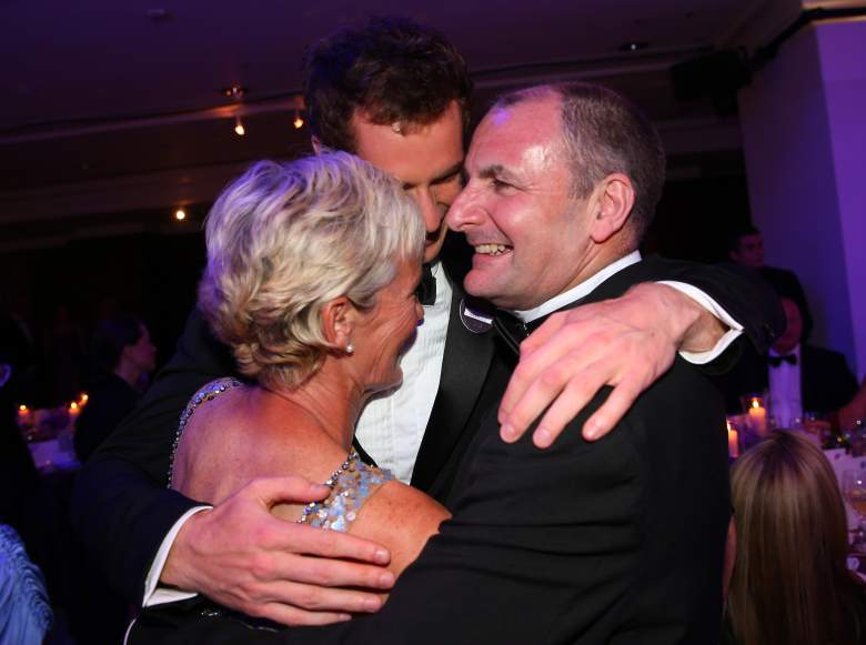 LONDON, ENGLAND - JULY 07:  Gentlemen's Singles Champion Andy Murray of Great Britain (C) hugs his parents Judy Murray and  William Murray during the Wimbledon Championships 2013 Winners Ball at InterContinental Park Lane Hotel on July 7, 2013 in London, England.  (Photo by Julian Finney/Getty Images)