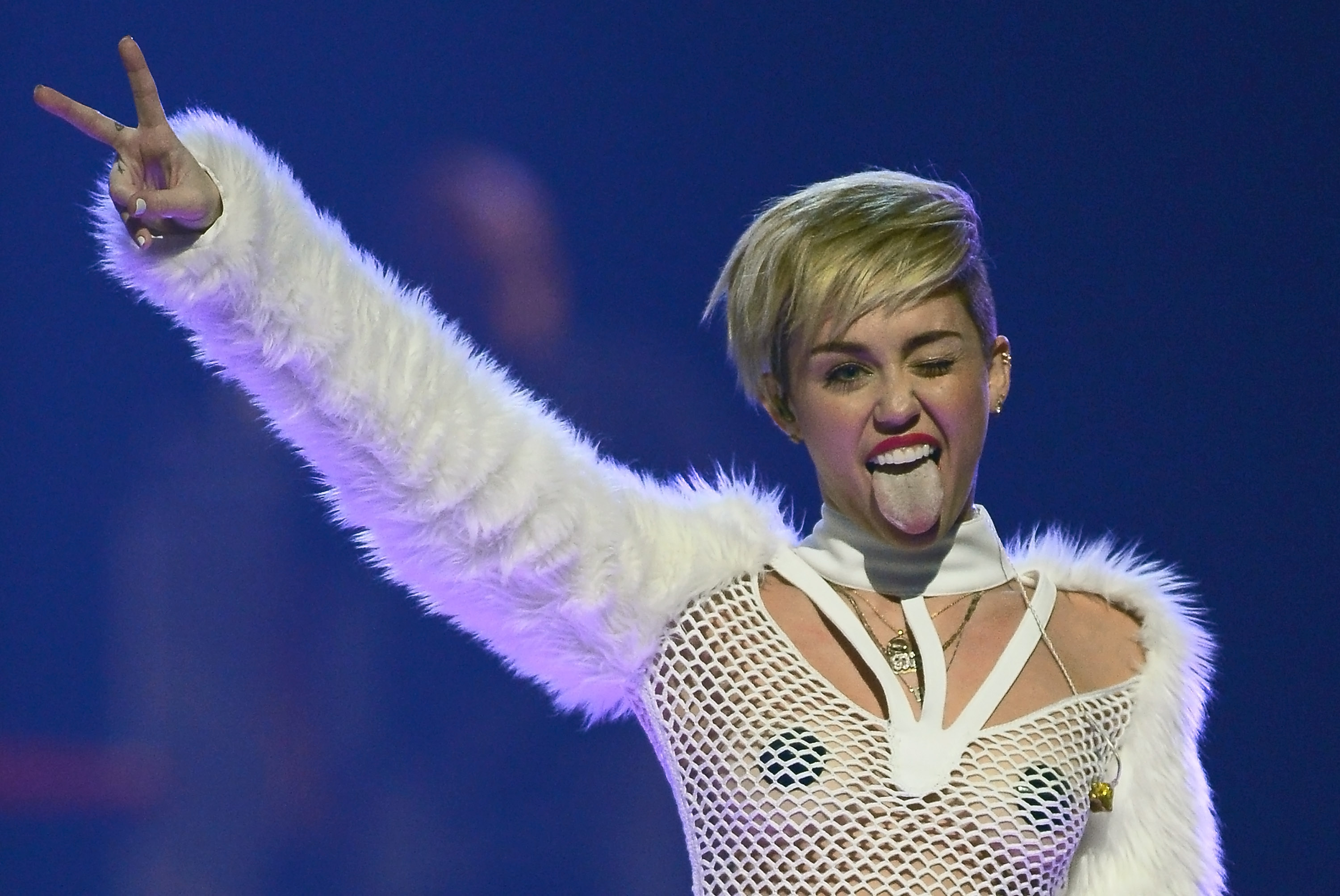LAS VEGAS, NV - SEPTEMBER 21:  Entertainer Miley Cyrus winks and sticks out her tongue as she performs during the iHeartRadio Music Festival at the MGM Grand Garden Arena on September 21, 2013 in Las Vegas, Nevada.  (Photo by Ethan Miller/Getty Images for Clear Channel)
