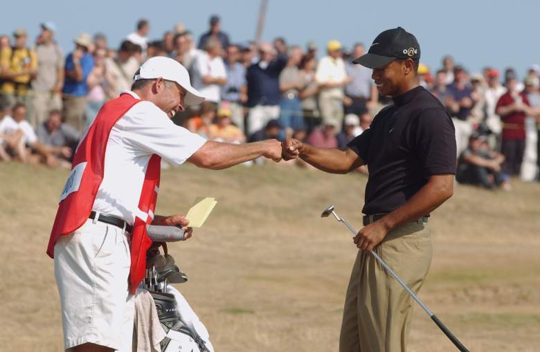 SANDWICH, ENGLAND - JULY 19: Tiger Woods of the USA celebrates with his caddie Steve Williams after his birdie on the eighth hole during the third round of The Open Championship on July 19, 2003 at the Royal St George's course in Sandwich, England. (Photo by Harry How/Getty Images)