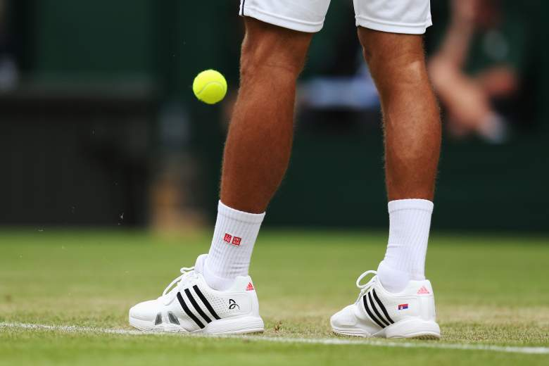 LONDON, ENGLAND - JUNE 25:  detailed shot of the adidas trainers of Novak Djokovic of Serbia as he bounces the ball prior to serving during his Gentlemen's Singles second round match against Radek Stepanek of Czech Republic on day three of the Wimbledon Lawn Tennis Championships at the All England Lawn Tennis and Croquet Club at Wimbledon on June 25, 2014 in London, England.  (Photo by Steve Bardens/Getty Images)