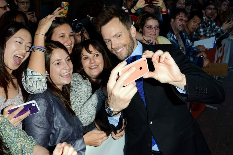 """TORONTO, ON - SEPTEMBER 08:  Actor Joel McHale takes a selfie with a fan at the """"Adult Beginners"""" premiere during the 2014 Toronto International Film Festival at Ryerson Theatre on September 8, 2014 in Toronto, Canada.  (Photo by Sarjoun Faour Photography/Getty Images)"""