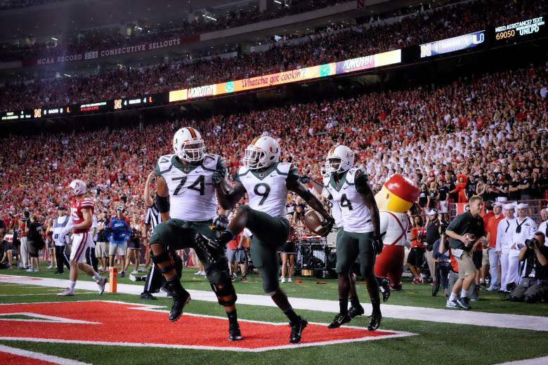 LINCOLN, NE - SEPTEMPER 20: Wide receiver Malcolm Lewis #9 and offensive linesman Ereck Flowers #74 of the Miami Hurricanes celebrate after scoring during their game against the Nebraska Cornhuskers at Memorial Stadium on September 20, 2014 in Lincoln, Nebraska. Nebraska defeated Miami 41-31. (Photo by Eric Francis/Getty Images)