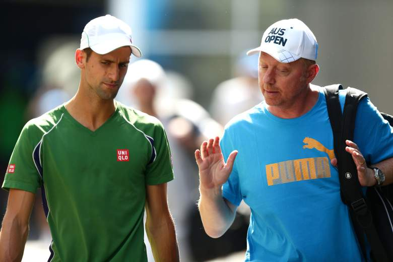 MELBOURNE, AUSTRALIA - JANUARY 14:  Novak Djokovic of Serbia and his coach Boris Becker talk during a practice session during day two of the 2014 Australian Open at Melbourne Park on January 14, 2014 in Melbourne, Australia.  (Photo by Matt King/Getty Images)