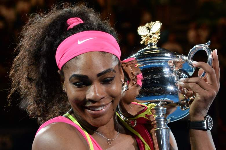 Serena Williams of the US holds the trophy as she celebrates after victory in her women's singles final match against Russia's Maria Sharapova on day thirteen of the 2015 Australian Open tennis tournament in Melbourne on January 31, 2015. AFP PHOTO / MAL FAIRCLOUGH -- IMAGE RESTRICTED TO EDITORIAL USE - STRICTLY NO COMMERCIAL USE        (Photo credit should read MAL FAIRCLOUGH/AFP/Getty Images)