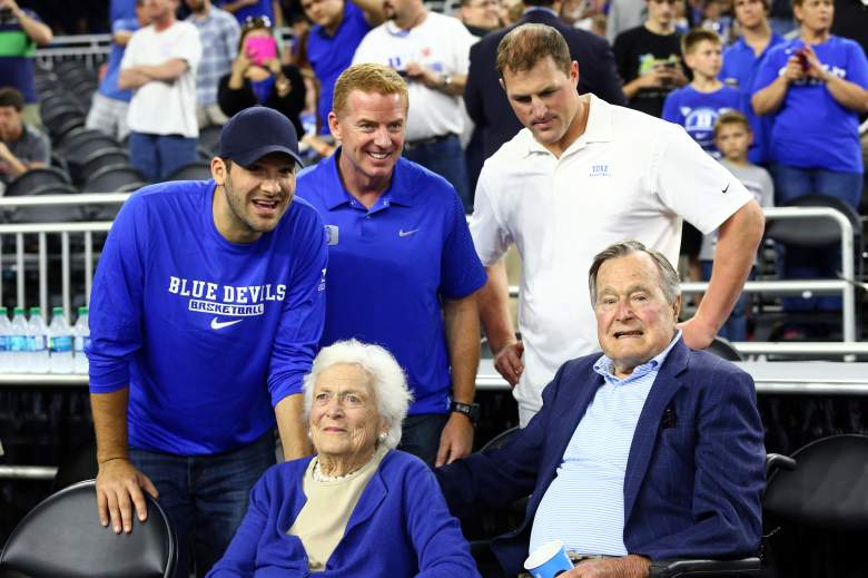 HOUSTON, TX - MARCH 29: (L-R) Tony Romo, Jason Garrett and Jason Witten of the Dallas Cowboys stand with former First Lady Barbara Bush and former President H.W. Bush (Getty)