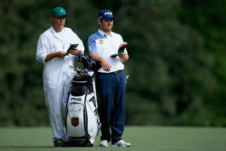 AUGUSTA, GA - APRIL 10:  Louis Oosthuizen of South Africa waits in the fifth fairway with his caddie Greg Hearmon during the second round of the 2015 Masters Tournament at Augusta National Golf Club on April 10, 2015 in Augusta, Georgia.  (Photo by David Cannon/Getty Images)