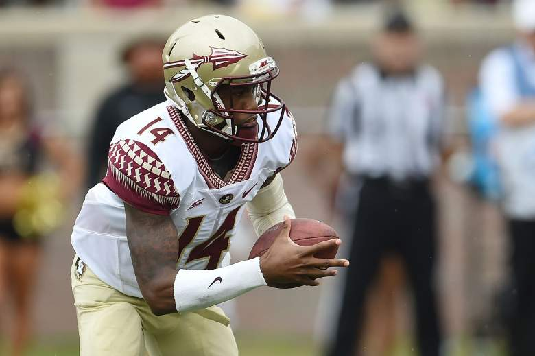 TALLAHASSEE, FL - APRIL 11:  De'Andre Johnson #14 of the Gold team runs for yards against the Garnet team during Florida State's Garnet and Gold spring game at Doak Campbell Stadium on April 11, 2015 in Tallahassee, Florida.  (Photo by Stacy Revere/Getty Images)