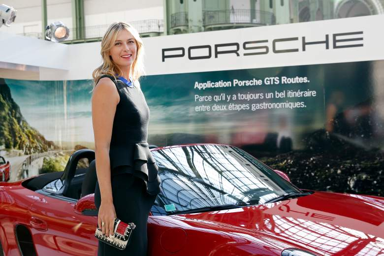 PARIS, FRANCE - MAY 21:  Porsche Brand Ambassador Maria Sharapova poses next to a Porsche model at the Taste of Paris event on May 21 in Paris, France.  (Photo by Thierry Chesnot/Getty Images For Porsche)