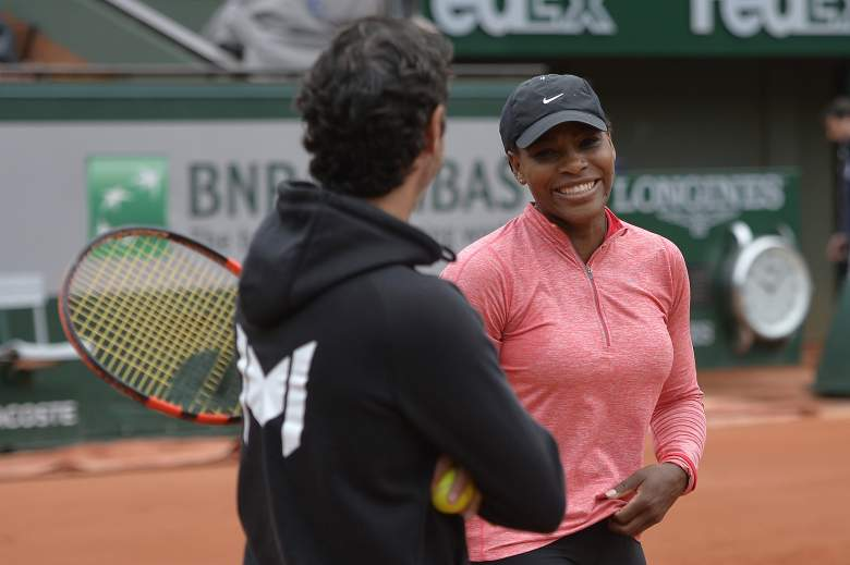 US Serena Williams speaks with her coach Patrick Mouratoglou (L) during a training session ahead of the Roland Garros 2015 French Tennis Open in Paris on May 23, 2015. AFP PHOTO / MIGUEL MEDINA        (Photo credit should read MIGUEL MEDINA/AFP/Getty Images)