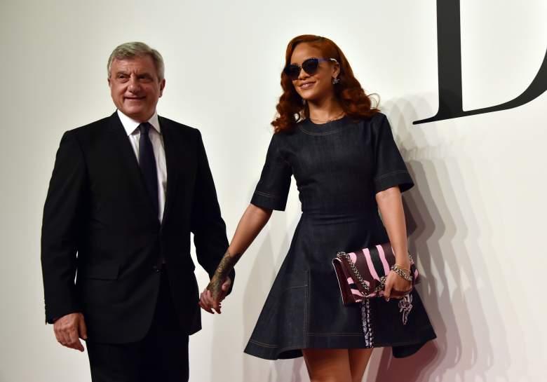 Christian Dior CEO Sidney Toledano (L) and Rihanna pose at a fashion show. (Getty)