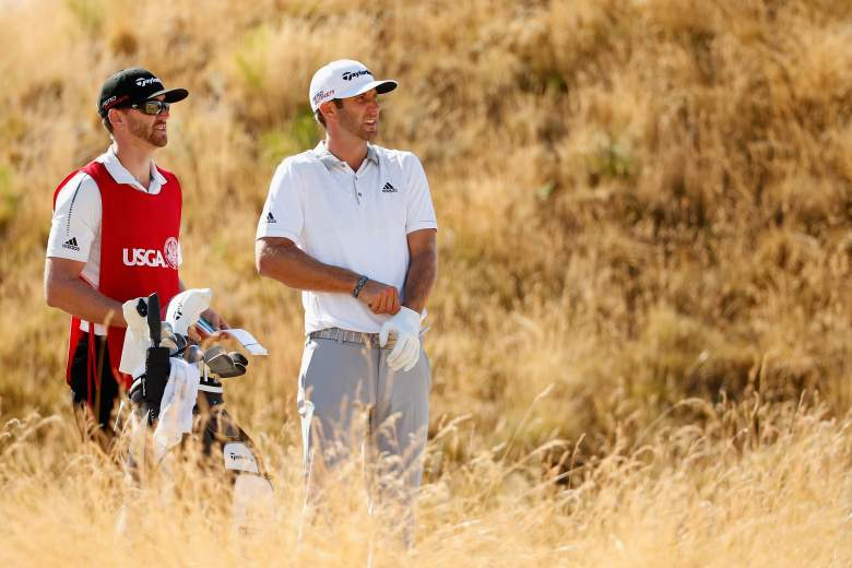 UNIVERSITY PLACE, WA - JUNE 21: Dustin Johnson of the United States stands with his caddie Austin Johnson on the seventh tee during the final round of the 115th U.S. Open Championship at Chambers Bay on June 21, 2015 in University Place, Washington.  (Photo by Ezra Shaw/Getty Images)