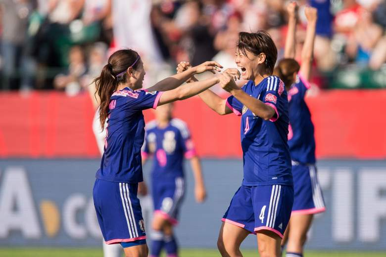 Japan's Aya Sameshima (L) and Saki Kumagai celebrate their  2-1 victory over England in their semifinal match at the FIFA Women's World Cup at Commonwealth Stadium in Edmonton, Canada on July 1, 2015.   AFP PHOTO/GEOFF ROBINS        (Photo credit should read GEOFF ROBINS/AFP/Getty Images)