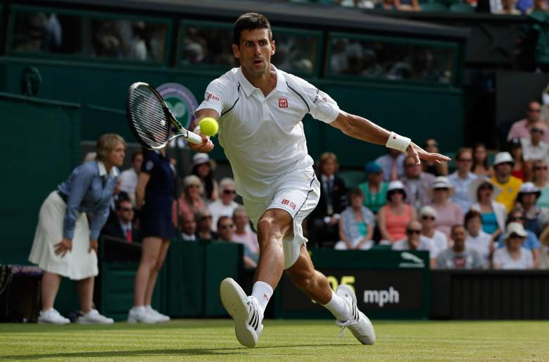 Serbia's Novak Djokovic returns to Australia's Bernard Tomic during their men's singles third round match on day five of the 2015 Wimbledon Championships at The All England Tennis Club in Wimbledon, southwest London, on July 3, 2015.   RESTRICTED TO EDITORIAL USE  --  AFP PHOTO / ADRIAN DENNIS        (Photo credit should read ADRIAN DENNIS/AFP/Getty Images)