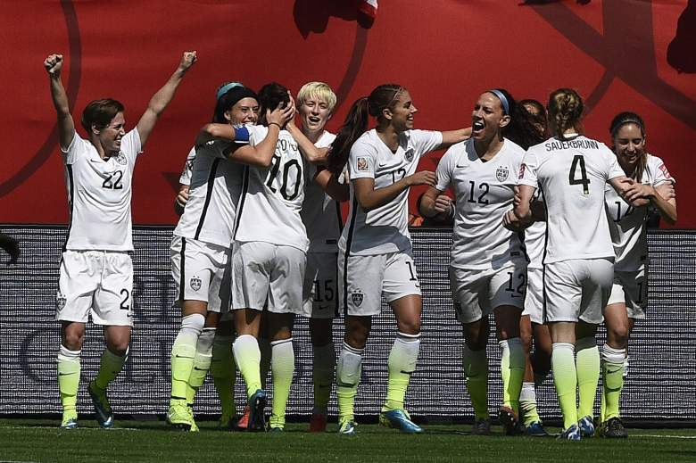 USA midfielder Carli Lloyd (10) is congratuled by after scoring a goal during the final football match between USA and Japan during their 2015 FIFA Women's World Cup at the BC Place Stadium in Vancouver on July 5, 2015.  AFP PHOTO / FRANCK FIFE        (Photo credit should read FRANCK FIFE/AFP/Getty Images)