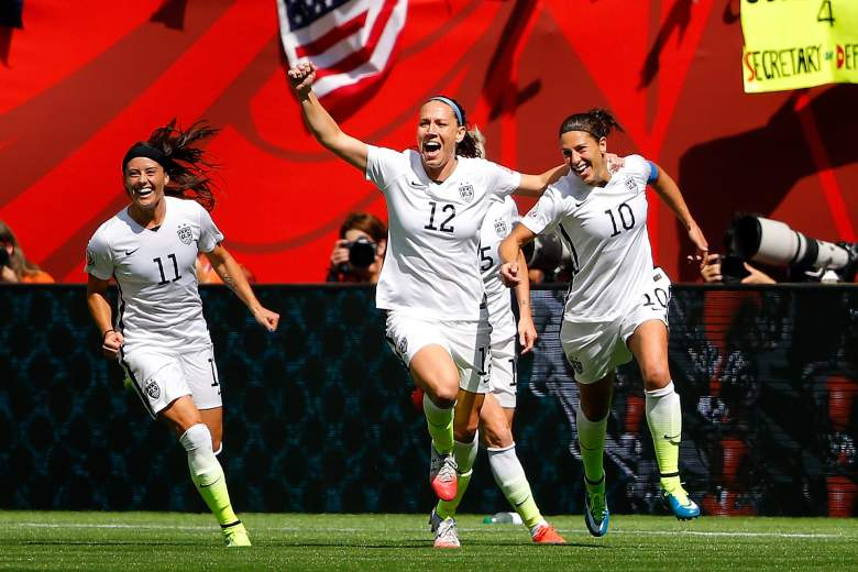 VANCOUVER, BC - JULY 05:  Lauren Holiday #12 and Carli Lloyd #10 of the United States celebrate with teammates after Lloyd scores her second goal against Japan in the FIFA Women's World Cup Canada 2015 Final at BC Place Stadium on July 5, 2015 in Vancouver, Canada.  (Photo by Kevin C. Cox/Getty Images)