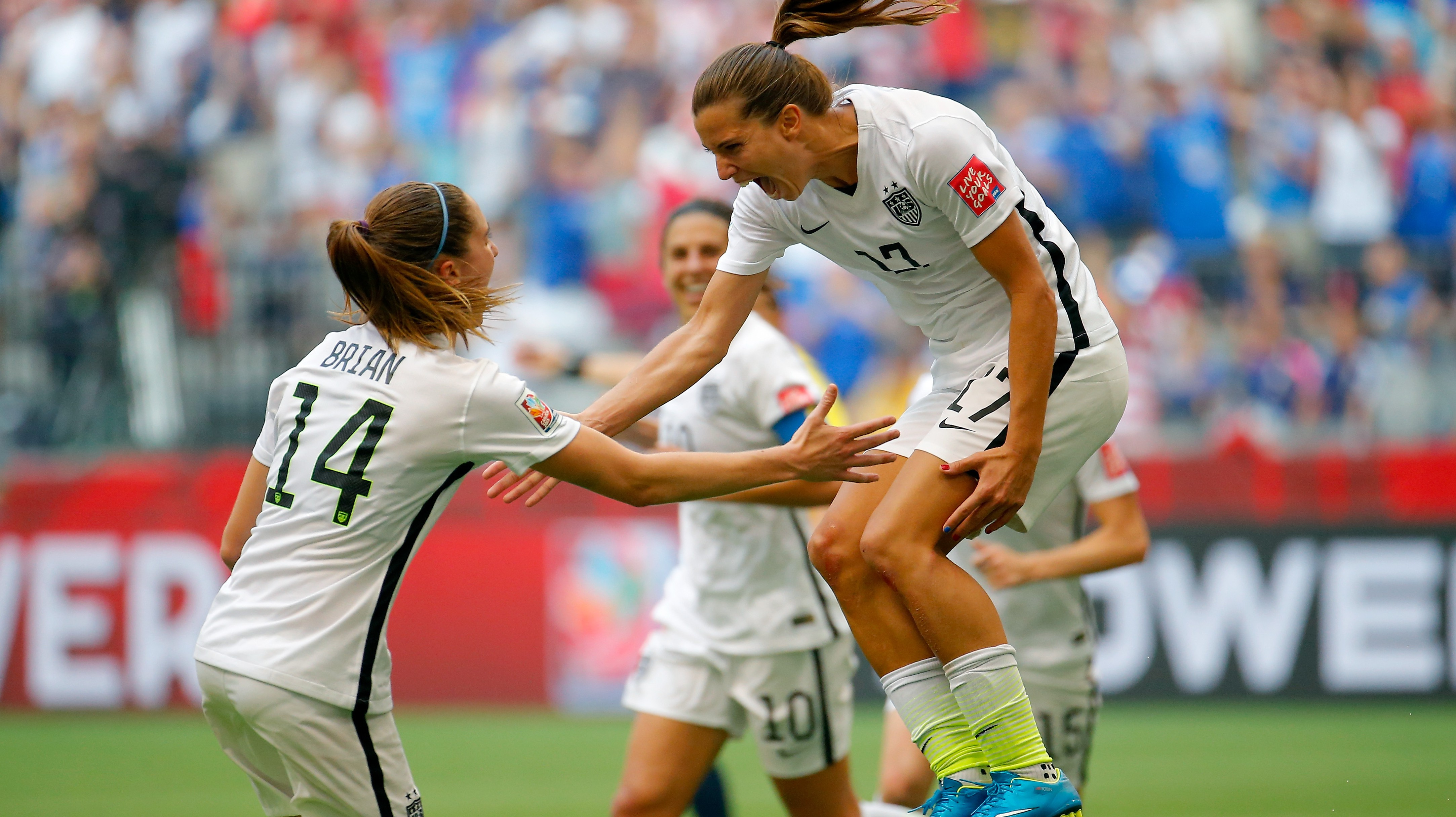 VANCOUVER, BC - JULY 05: Tobin Heath #17 of the United States celebrates with Morgan Brian #14 after Heath scores in the second half against Japan in the FIFA Women's World Cup Canada 2015 Final at BC Place Stadium on July 5, 2015 in Vancouver, Canada. (Photo by Kevin C. Cox/Getty Images)