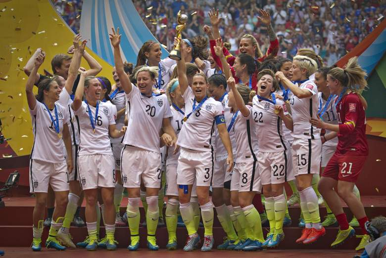 Members of the USA celebrate winning the the championship football match against Japan at during the 2015 FIFA Women's World Cup in Vancouver on July 5, 2015.   AFP PHOTO/ANDY CLARK        (Photo credit should read ANDY CLARK/AFP/Getty Images)