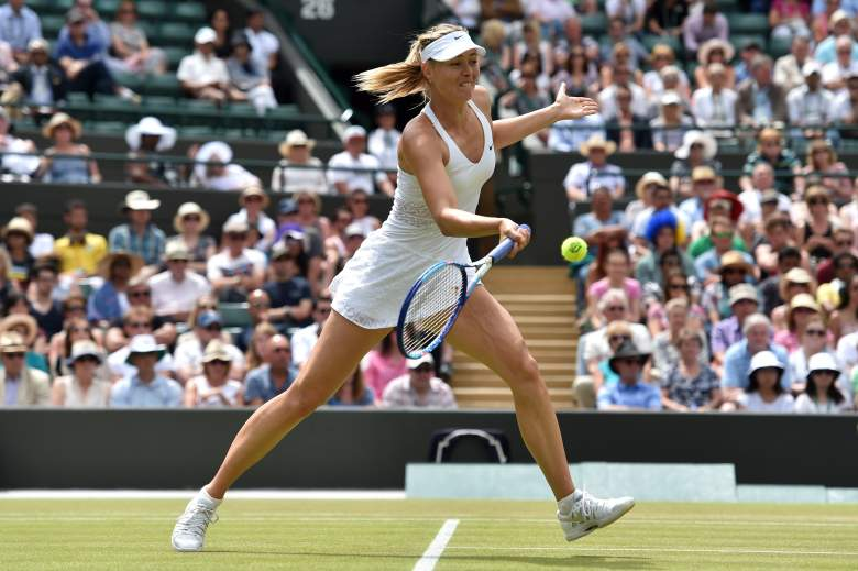 Russia's Maria Sharapova returns against Kazakhstan's Zarina Diyas during their women's singles fourth round match on day seven of the 2015 Wimbledon Championships at The All England Tennis Club in Wimbledon, southwest London, on July 6, 2015.   RESTRICTED TO EDITORIAL USE  --   AFP PHOTO / GLYN KIRK        (Photo credit should read GLYN KIRK/AFP/Getty Images)