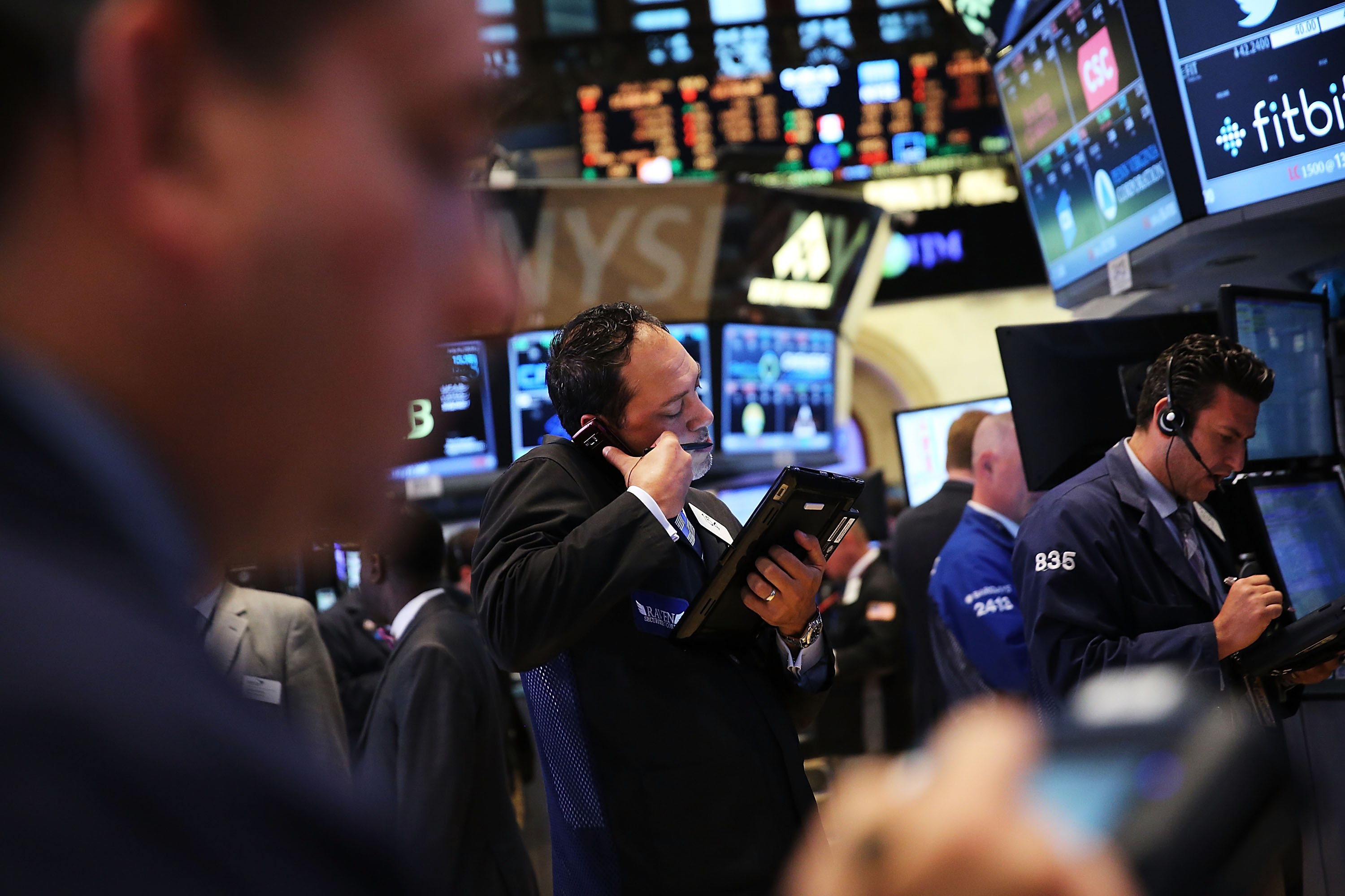 Traders work on the floor of the New York Stock Exchange on July 6, 2015. (Getty)