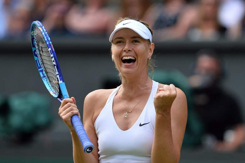 Russia's Maria Sharapova celebrates beating US player Coco Vandeweghe during their women's quarter-finals match on day eight of the 2015 Wimbledon Championships at The All England Tennis Club in Wimbledon, southwest London, on July 7, 2015.  Sharapova won the match 6-3, 6-7, 6-2.  RESTRICTED TO EDITORIAL USE  -- AFP PHOTO / GLYN KIRK        (Photo credit should read GLYN KIRK/AFP/Getty Images)