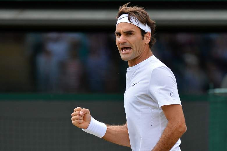 Switzerland's Roger Federer reacts against France's Gilles Simon during their men's quarter-finals match on day nine of the 2015 Wimbledon Championships at The All England Tennis Club in Wimbledon, southwest London, on July 8, 2015. Federer won the match 6-3, 7-5, 6-2. RESTRICTED TO EDITORIAL USE  --  AFP PHOTO / GLYN KIRK        (Photo credit should read GLYN KIRK/AFP/Getty Images)