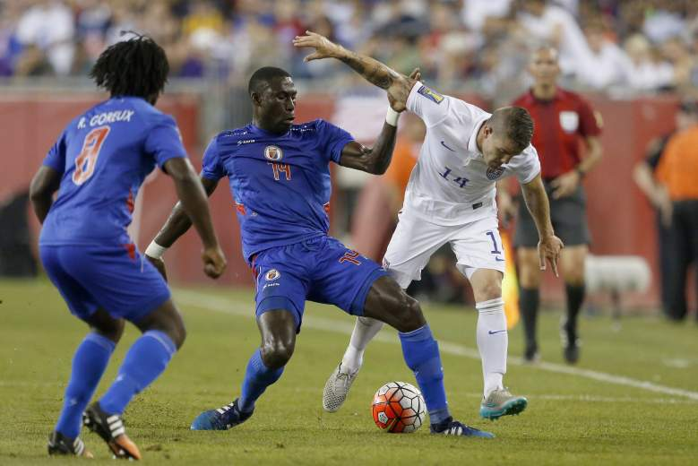 Haiti's James Marcelin (C) tackles United States' Greg Garza during the CONCACAF Gold Cup match between the United States and Haiti, July 10, 2015, in Foxborough, Massachusetts. AFP PHOTO/DOMINICK REUTER        (Photo credit should read DOMINICK REUTER/AFP/Getty Images)