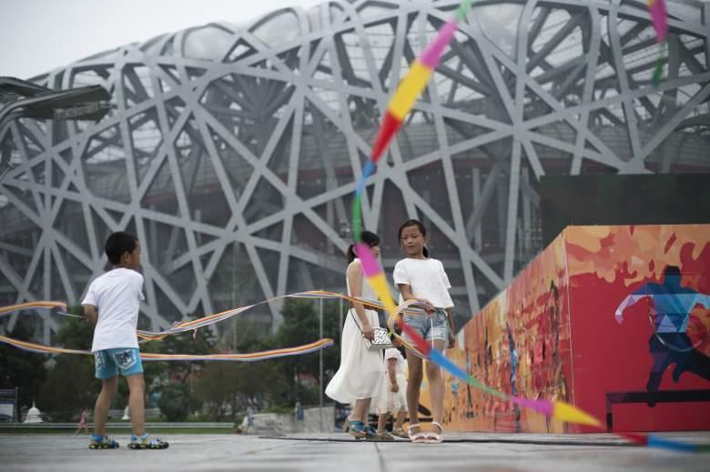 Children play in front of the Bird's Nest stadium in Beijing (Getty)