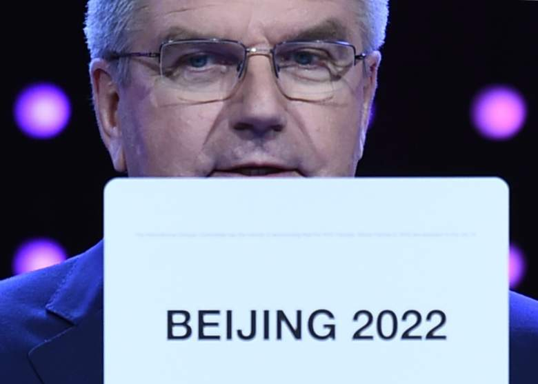International Olympic Committee (IOC) president Thomas Bach shows the card with the name Beijing  (Getty)