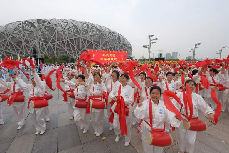 People celebrate at Olympic Plaza in Beijing (Getty)