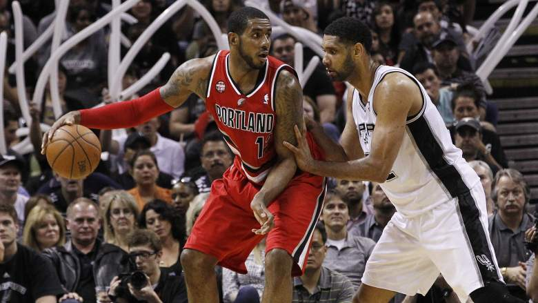 With the San Antonio Spurs' trade of Tiago Splitter, there's a chance LaMarcus Aldridge (L) and Tim Duncan may soon be teammates for Gregg Popovich's squad. (Getty)