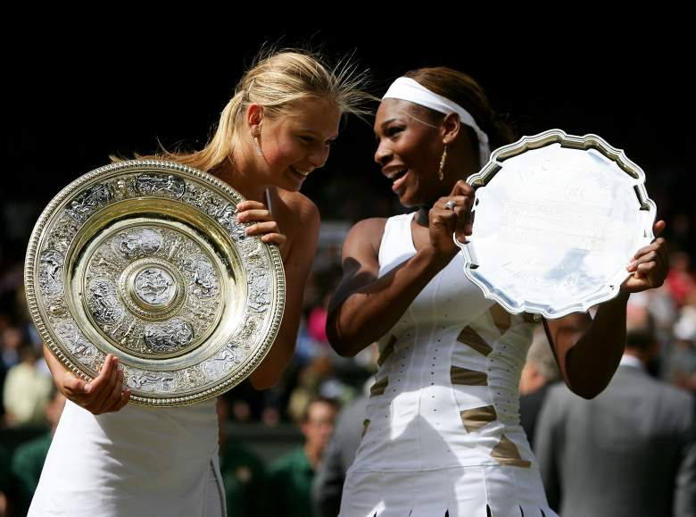 Sharapova and Williams pose with their trophies following Sharapova's triumph at Wimbledon in 2004. (Getty)