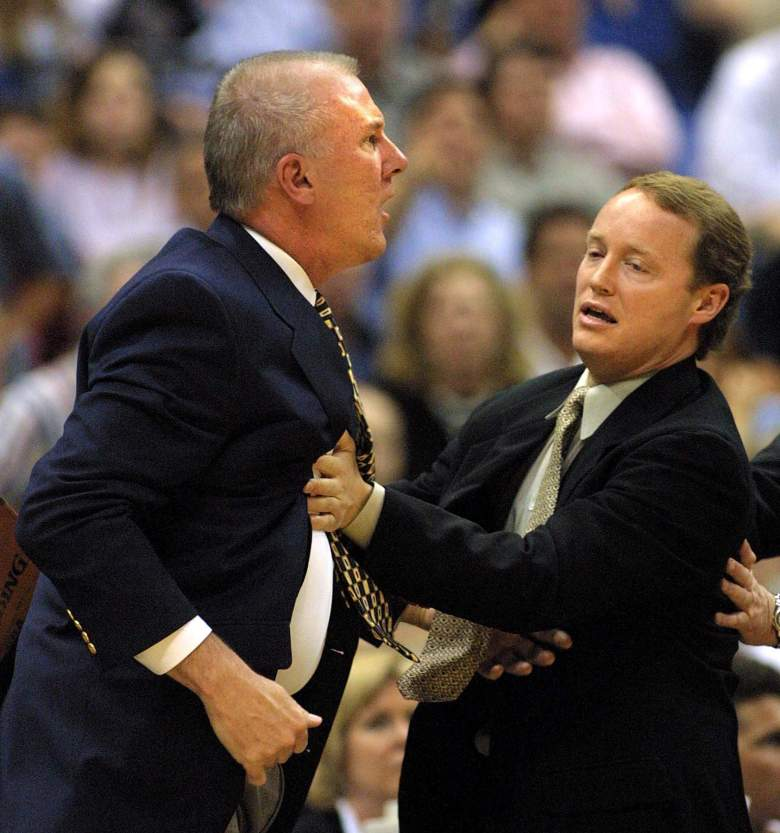 Mike Budenholzer (R), now the head coach of the Atlanta Hawks, holds back San Antonio Spurs head coach Gregg Popovich in 2001. (Getty)