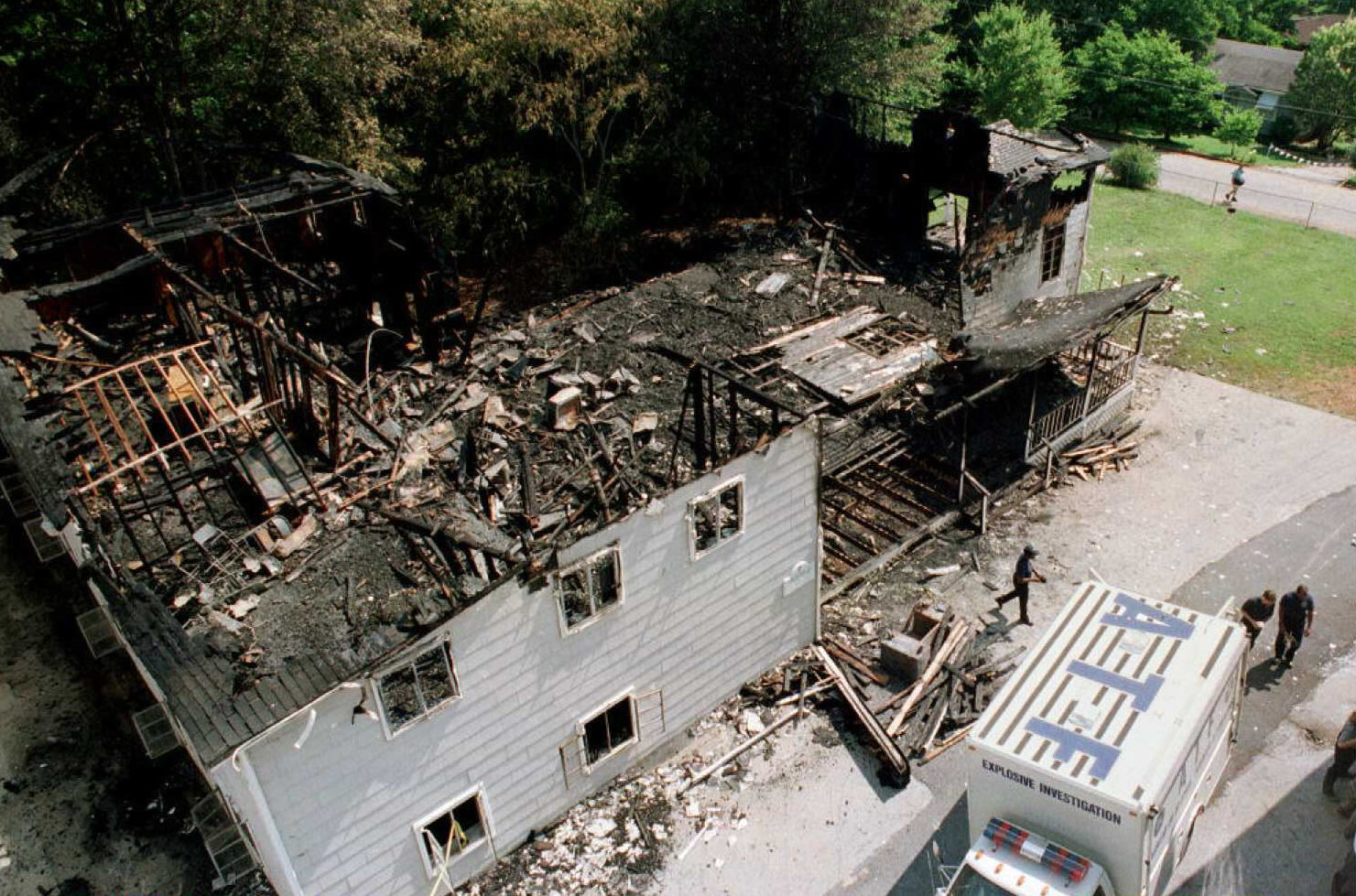 Bureau of Alcohol, Tobacco and Firearms (ATF) investigators inspect the scene of a fire at predominantly African-American Pine Lake Baptist Church in Pine Lake, Georgia, June 17, 1995. (Getty)