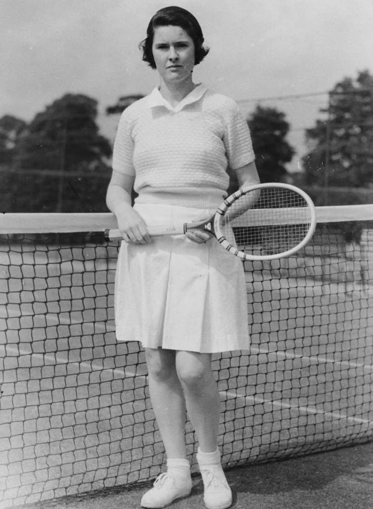 Portrait of tennis player Sarah Palfrey Fabyan, wearing tennis whites as she practices at Wimbledon, London, June 12th 1934. (Photo by Fox Photos/Hulton Archive/Getty Images)