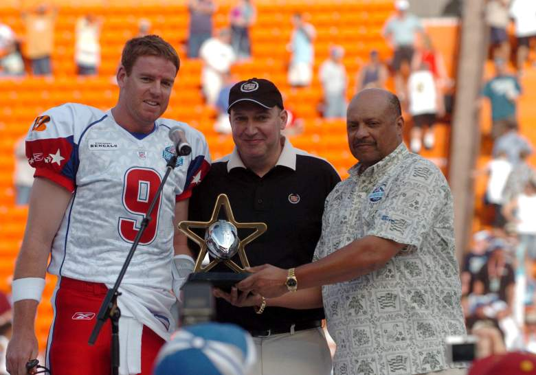 Cincinnati Bengals quarterback Carson Palmer received the MVP award from Cadillac director of retail development Jon Brancheau and NFL vice president Harold Henderson during the NFL Pro Bowl game at Aloha Stadium in Honolulu, Hawaii on February 10, 2007  (Photo by Al Messerschmidt/Getty Images)