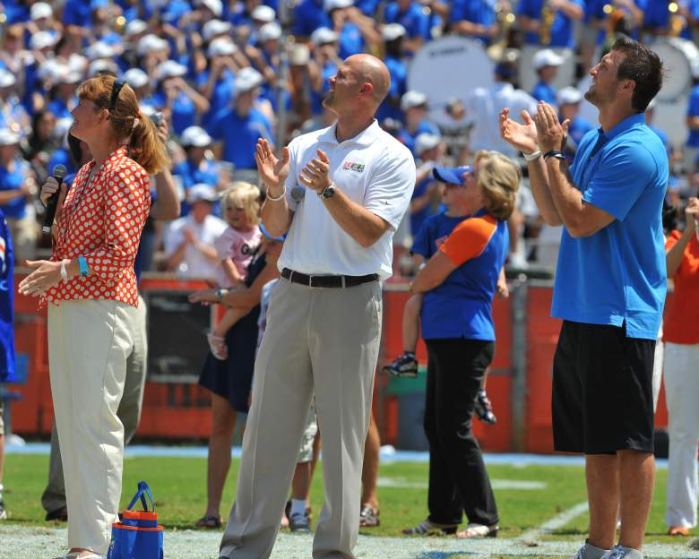 GAINESVILLE, FL - APRIL 9: Amy Moody (left), the daughter of Steve Spurrier, Danny Wuerffel and Tim Tebow watch a scoreboard as life-size statues of the Florida Gators three Heisman trophy winners are unveiled at halftime of the Orange and Blue spring football game April 9, 2011 Ben Hill Griffin Stadium at Gainesville, Florida. (Photo by Al Messerschmidt/Getty Images)