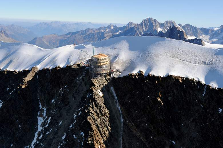 "A picture taken on September 30, 2011 shows the building site of the new ""Refuge du Goûter"" at the Dôme du Goûter (4.304 meters high) on the way to the summit of Mont Blanc. By its size and the altitude, the reconstruction of the ""Refuge du Goûter"" is a major undertaking, construction began in summer 2010, and the end of works is planned for June 2012. The ovoid architecture of the project was designed to fit to aesthetical and technical environmental constraints. AFP PHOTO / JEAN-PIERRE CLATOT (Photo credit should read JEAN-PIERRE CLATOT/AFP/Getty Images)"